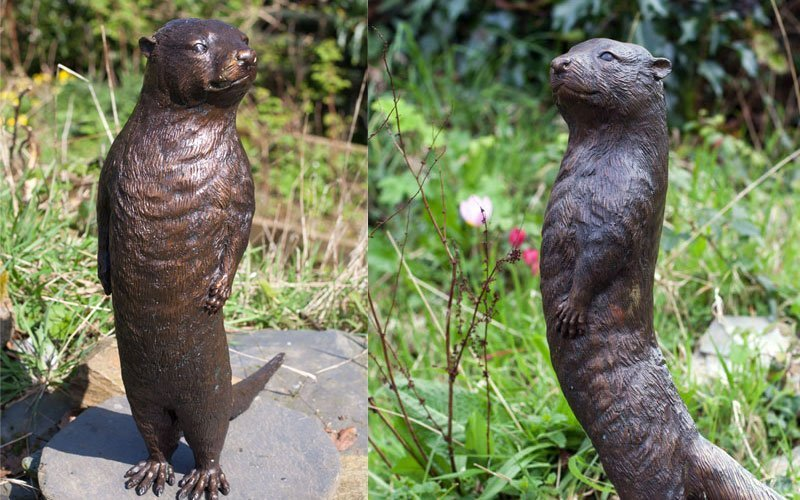 Bronze otter statue